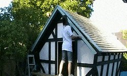 10 x 10 Tudor Style Shed : shed roof trim being fixed