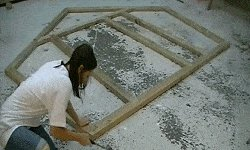 10 x 10 Tudor Style Shed : shed wall frames being assembled