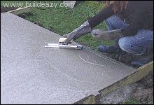 Concrete floor being smoothed with a trowel
