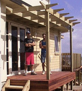 photo of finished pergola and the builders