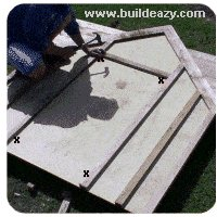 making the playhouse window and door openings
