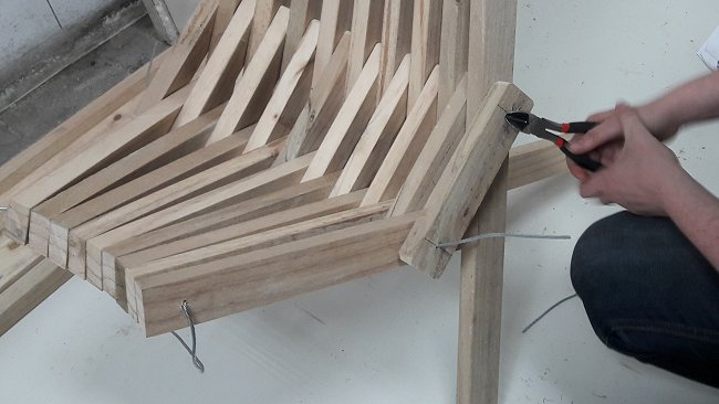 stick chair holding wire being trimmed