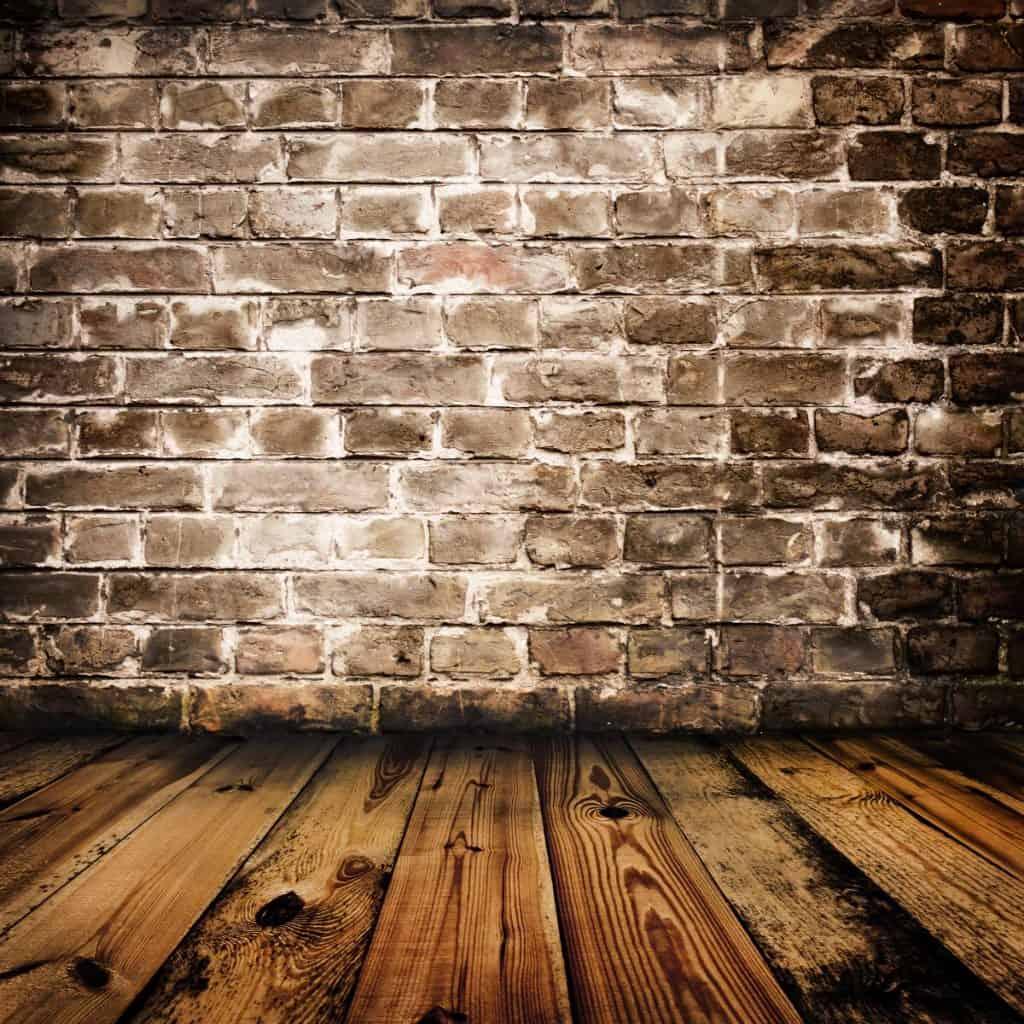 Brick Wall on Top of Wooden Floor