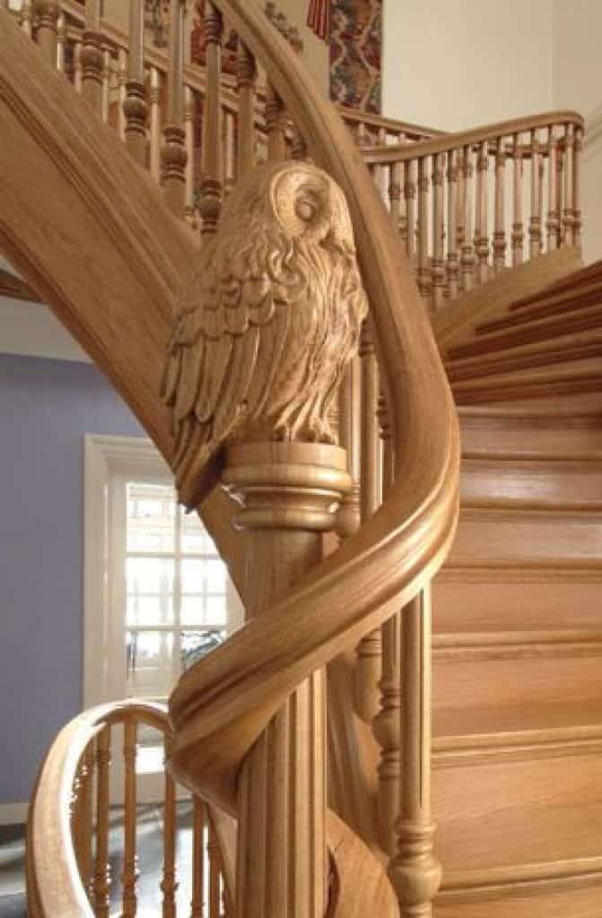 Traditional Wooden Staircase with Owlet Sculptures