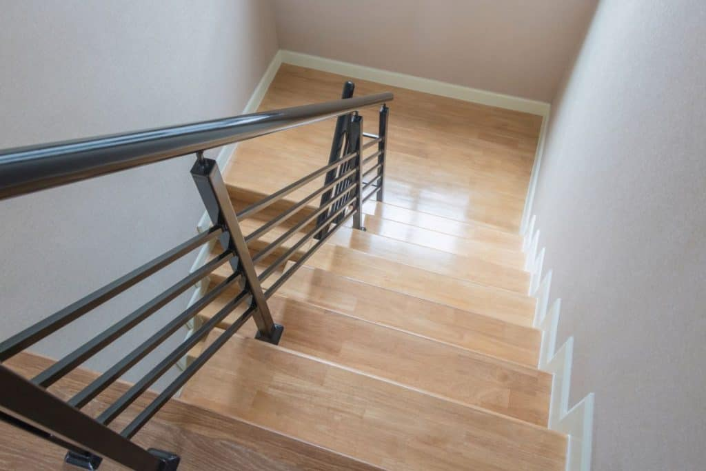 Wooden Stairs with Iron Handrail